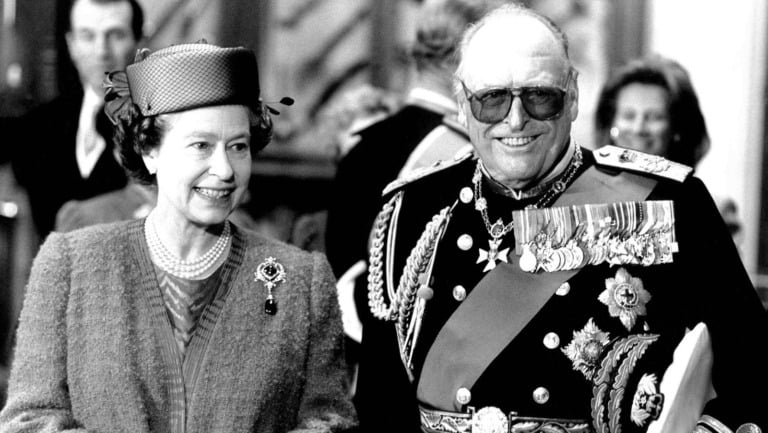 The Queen welcoming Norway's King Olav to Windsor Castle for a state visit.