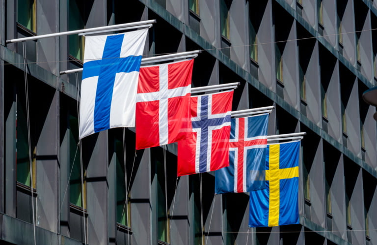 Nordic region flags on a building