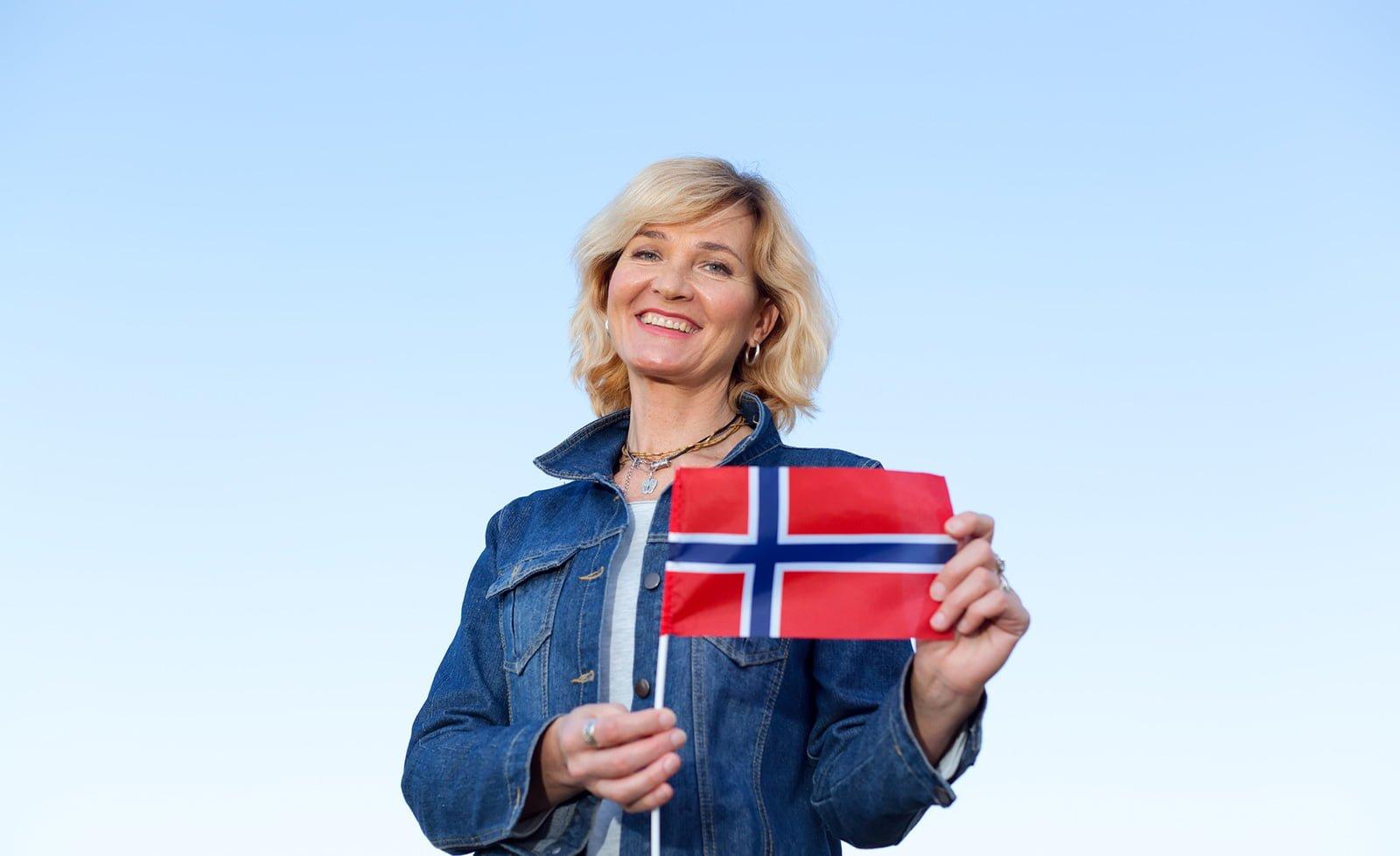 Norwegian language exam student with the flag of Norway
