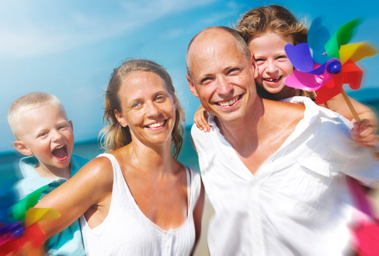 A Scandinavian family portrait with two Swedish parents and two young children.