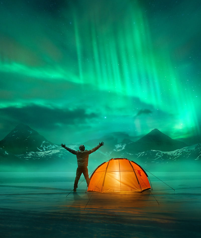 Camping under the green northern lights in Scandinavia
