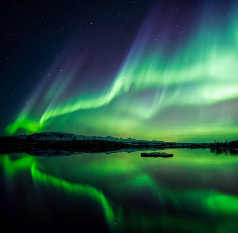 Green aurora reflected in a Scandinavian lake.
