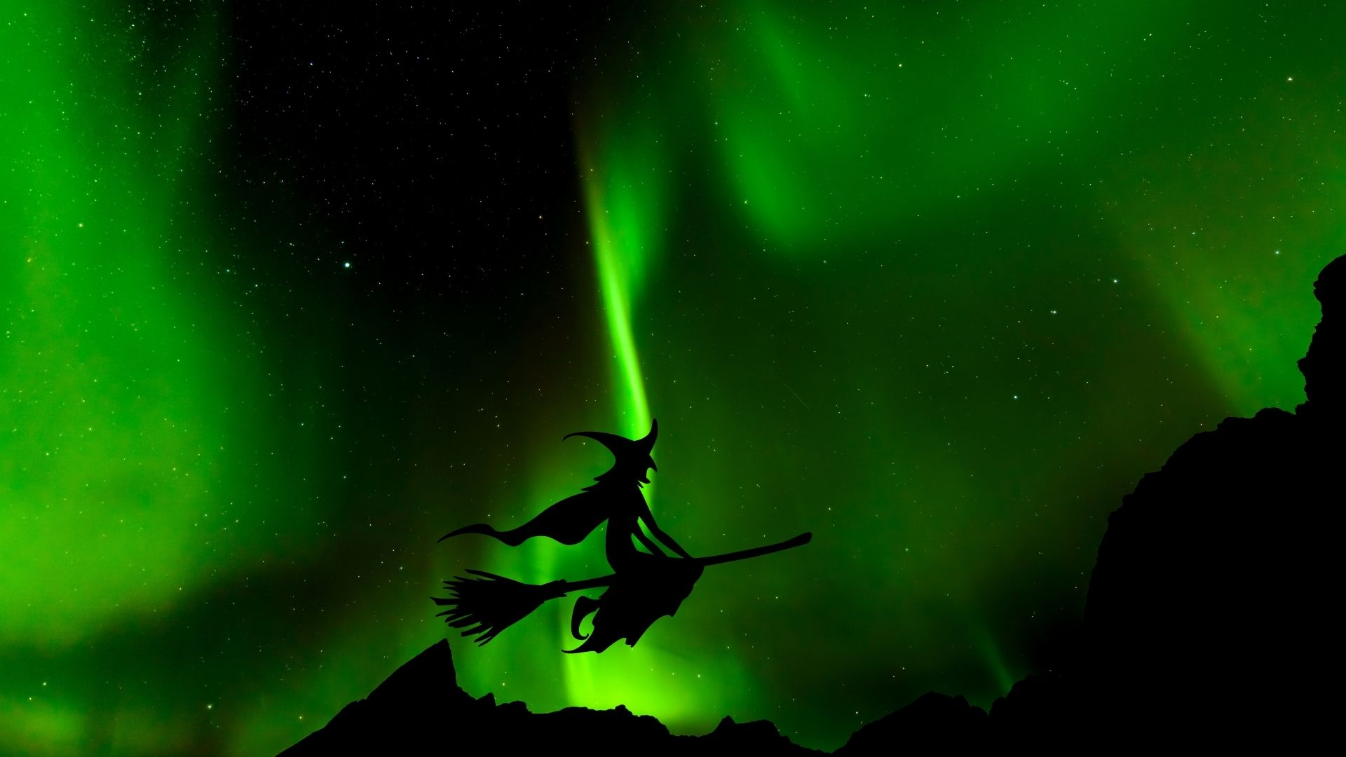 Norwegian witch flying in front of the northern lights in Norway