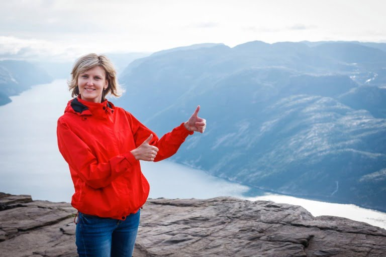 A Norwegian girl in front of a fjord in Norway.