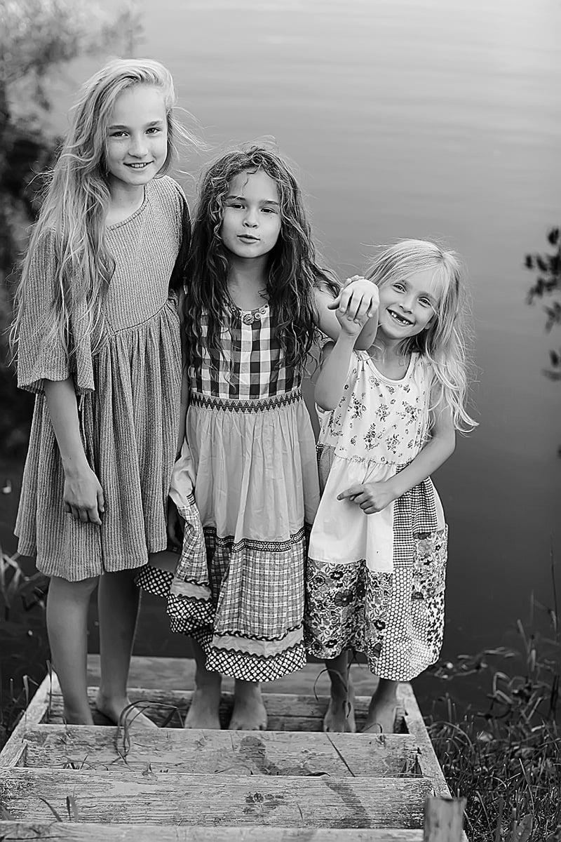 Three Norwegian girls by a fjordside in Norway