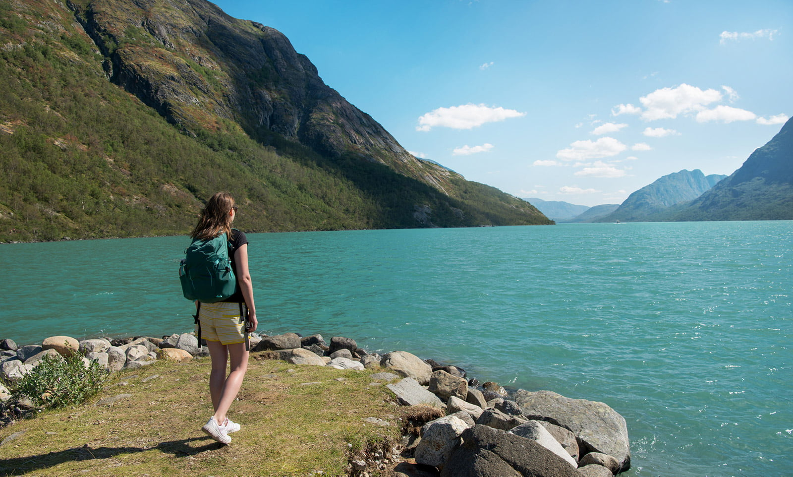 A Norwegian citizen hiking by a fjord