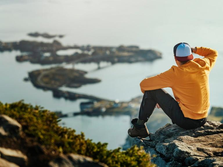 Tourist hiker in Norway's Lofoten islands