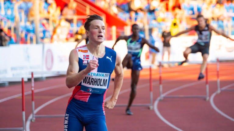 Norwegian athlete Karsten Warholm in a hurdles race