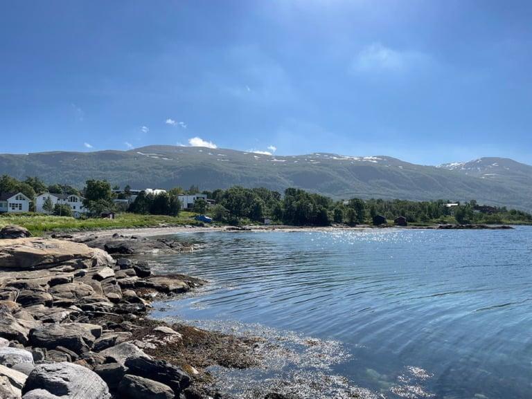 The calm water at Telegrafbukta bay in Tromsø, Northern Norway