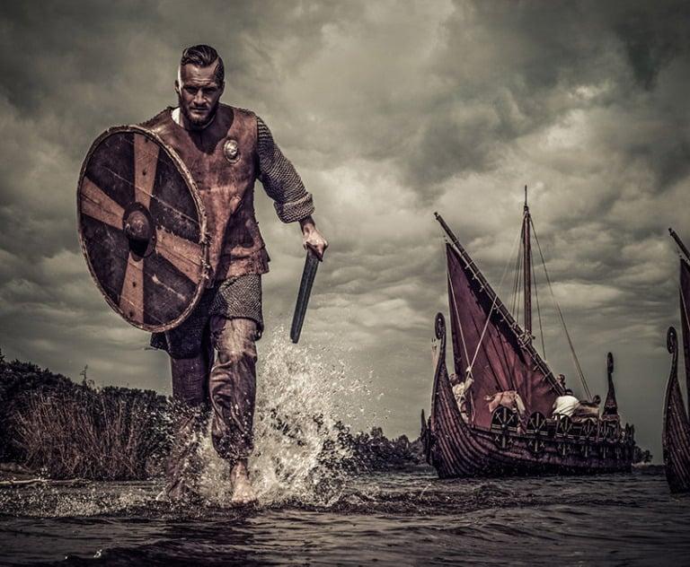 A Viking warrior rushing to shore