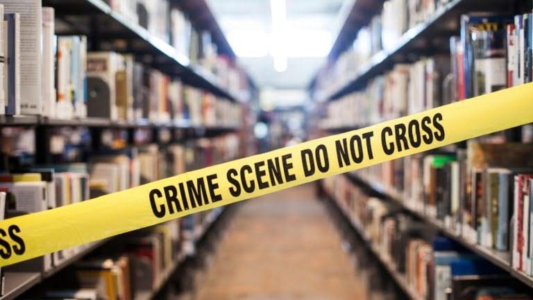Crime books with crime scene tape
