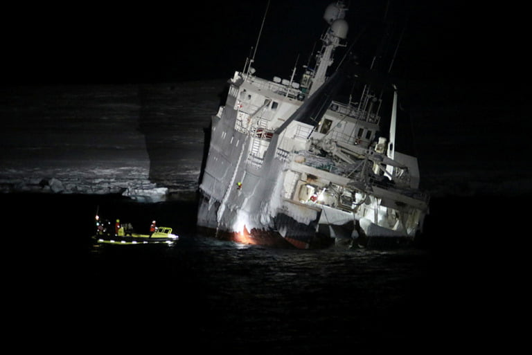 Norwegian Coast Guard supporting Northguider after the vessel crashed on Svalbard.