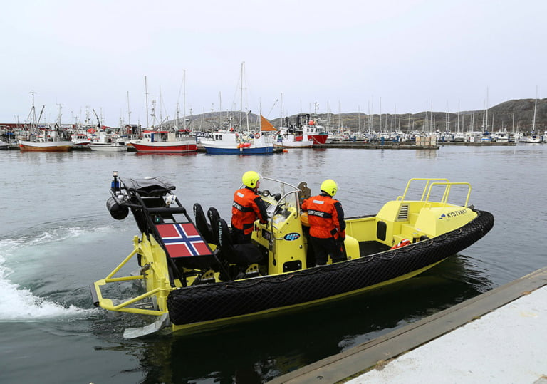 A small boat belonging to the Coast guard vessel KV Senja on its way out from Bodø harbour.