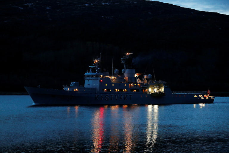 Coast Guard vessel Senja by the coastline of Troms and Finnmark county in Northern Norway.