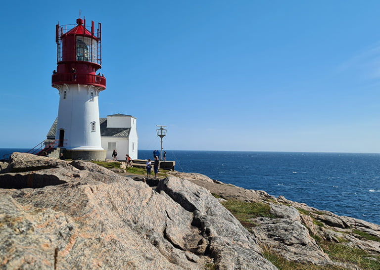 Tourists at Lindesnes lighthouse in Southern Norway