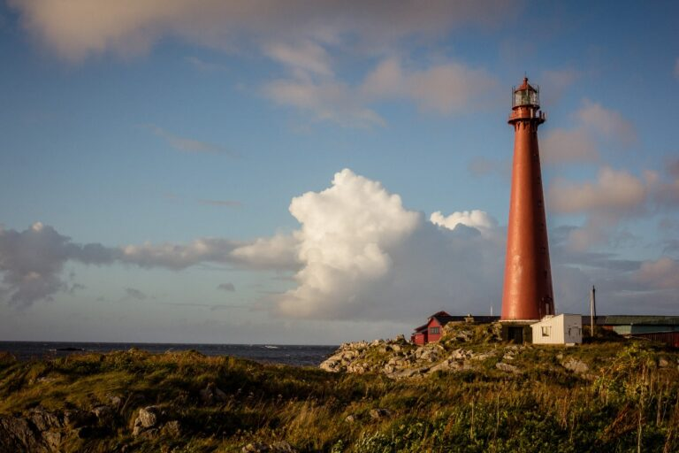 The dark red Andenes lighthouse