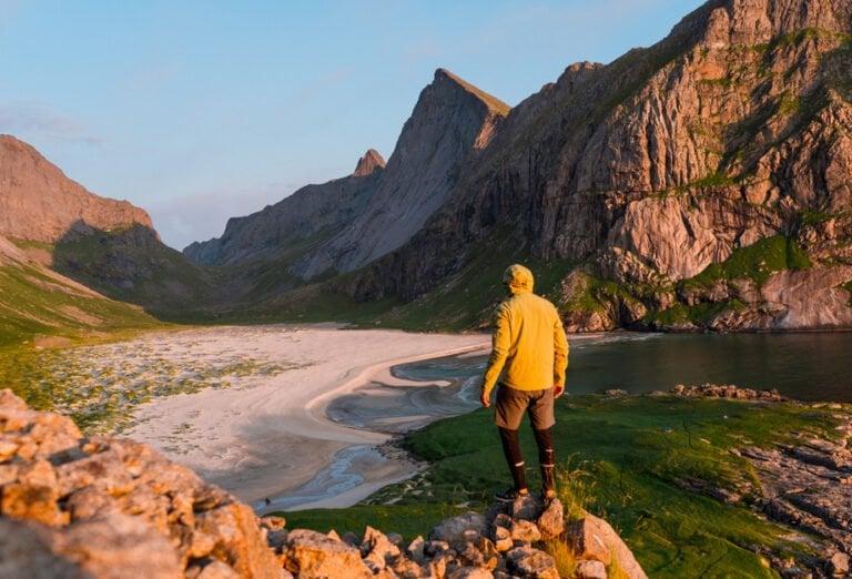 Hiker at Bunes Beach in Lofoten
