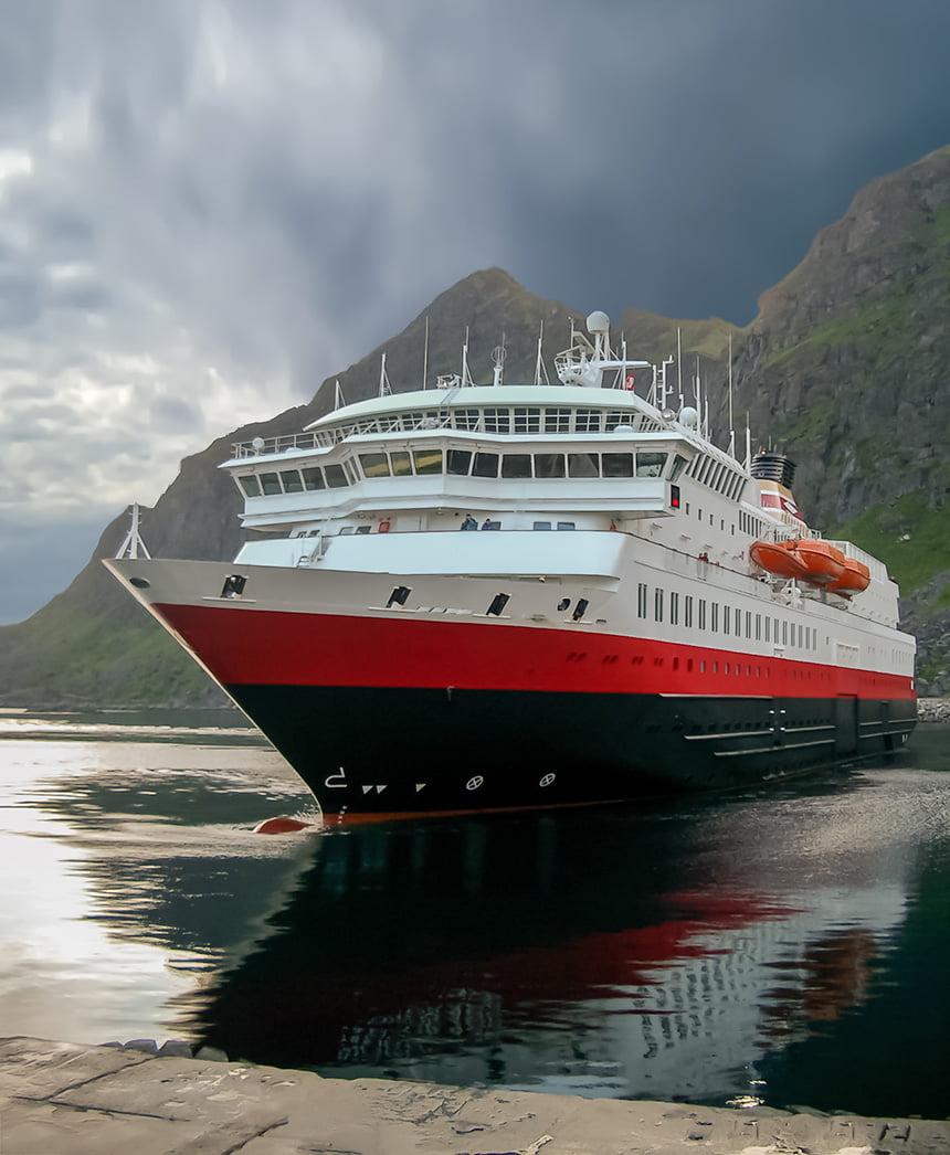 Hurtigruten vessel sailing into Stamsund port, Norway