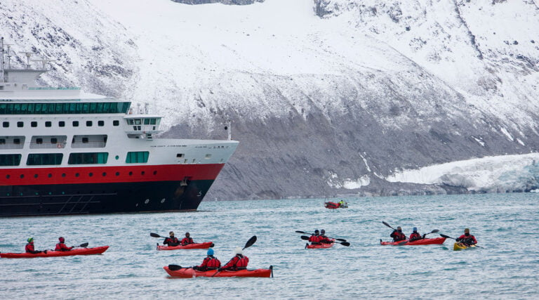Kayakers from a cruise ship in the waters of Svalbard