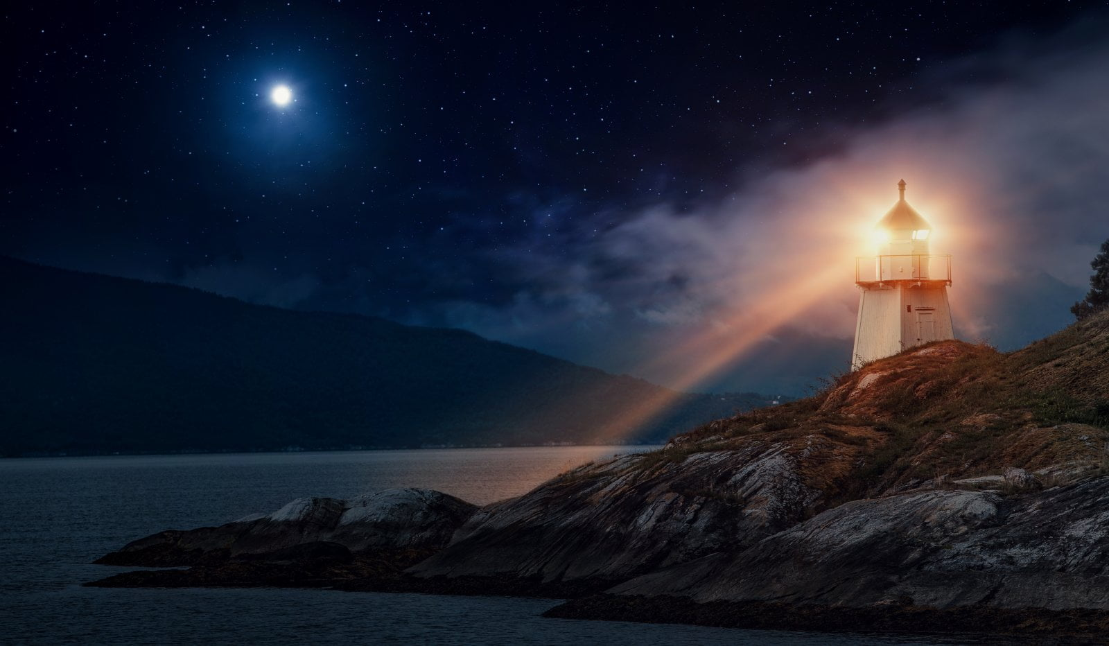 A lighthouse in Norway at night on the Norwegian coastline