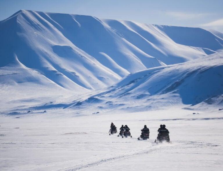 Snow scooter tourists on Svalbard
