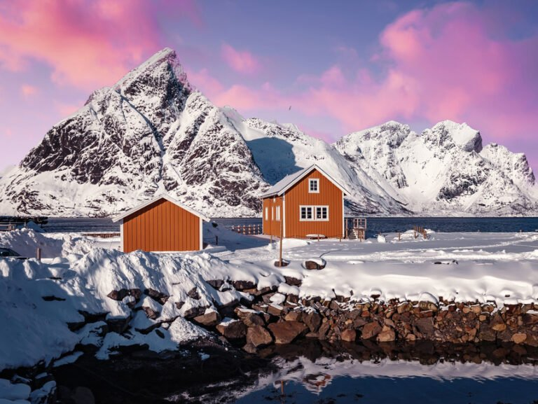 Yellow cabins and a pink sky in a Lofoten winter