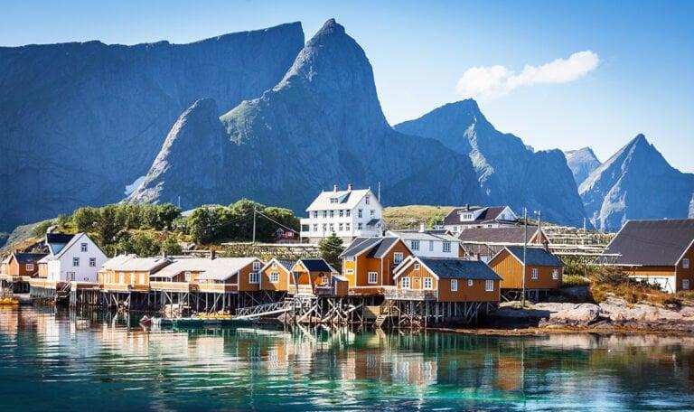 Yellow houses on the Lofoten islands coastline in Northern Norway