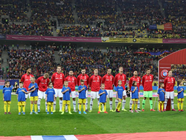 Norway national football team stand for the national song