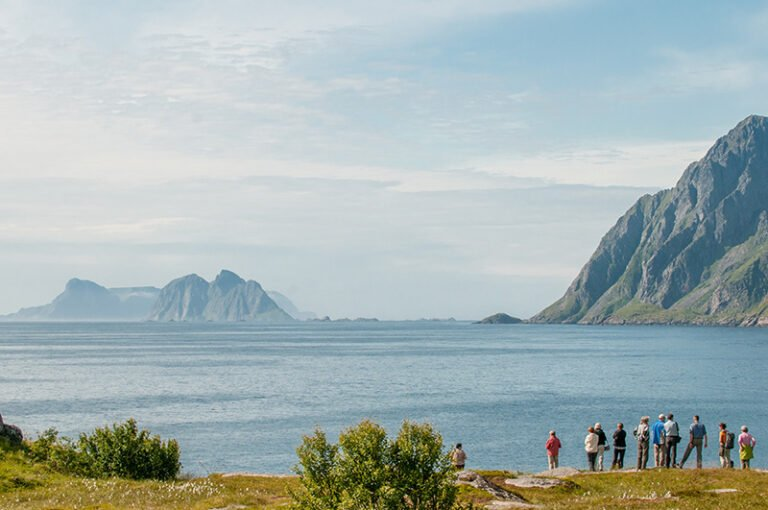 A group of tourists at the end of the Lofoten islands
